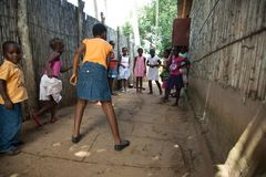 Mozambique Pentacostal Church gathering scenes in Xai Xai. Children playing hopscotch outside the church during the service - A series of images from Mozambique royalty free stock photography
