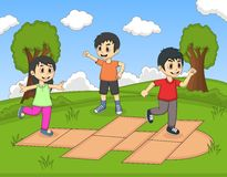 Children playing hopscotch at the park cartoon Royalty Free Stock Photo