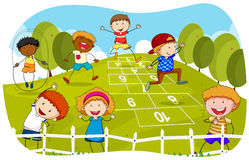Children playing hopscotch in the park Stock Photos