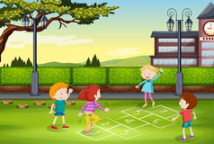 Children playing hopscotch in the park Stock Photo