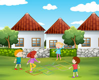 Children playing hopscotch in the yard Royalty Free Stock Image