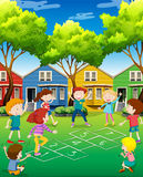 Children playing hopscotch in the yard Royalty Free Stock Photo