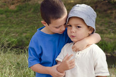 Children playing and hugging. Two children brothers playing and hugging in nature stock photo