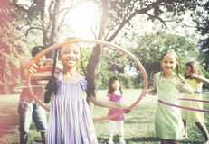 Children Playing Hula Hoop Activity Concept Stock Images