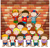 Children playing human pyramid together Royalty Free Stock Images