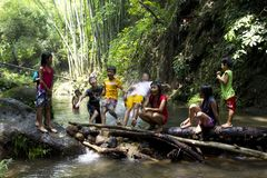 Children Playing In A River Stock Photo