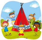 Children playing indians by the teepee Stock Photo