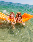 Children playing on a inflatable mattress Stock Photography