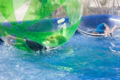 Children playing in an inflatable plastic balloon on the water Royalty Free Stock Image