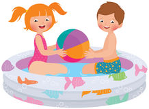 Children playing in inflatable pool Royalty Free Stock Images