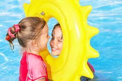 Children playing inflatable ring. Stock Photo