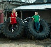 Children playing in junkyard tires Royalty Free Stock Photo
