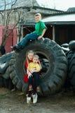 Children playing in junkyard tires Royalty Free Stock Photos