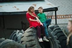 Children playing in junkyard tires Stock Photos