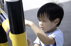 Children are playing. Kids can enjoy playing in the parking lot Royalty Free Stock Photo