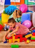 Children playing in kids club indoor. Lesson in primary school. Royalty Free Stock Image