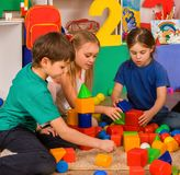 Children playing in kids cubes indoor. Lesson in primary school. Royalty Free Stock Photos
