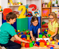 Children playing in kids cubes indoor. Lesson in primary school. Stock Images