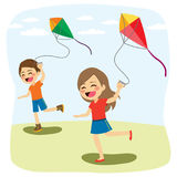 Children Playing Kite. Cute young children friends playing and flying colorful kite over blue sky royalty free illustration