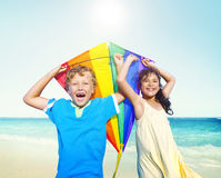 Children Playing Kite Happiness Cheerful Beach Summer Concept Stock Photos