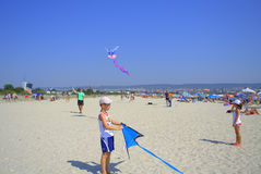 Children playing kites on the beach Royalty Free Stock Photography
