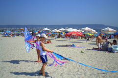 Children playing kites on the beach Stock Photography