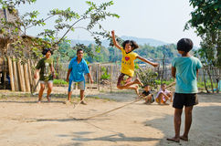 Children playing Kra Dod Cheark (the rope jumpin royalty free stock images