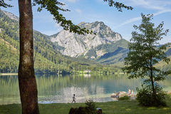 Children playing at the lake Vorderer Langbathsee in Salzkammerg. Ut, Austria Royalty Free Stock Photography