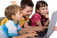 Children Playing on Laptop Stock Photo