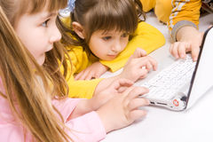 Children playing on laptop Royalty Free Stock Image