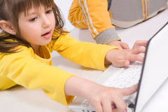 Children playing on laptop Royalty Free Stock Photos