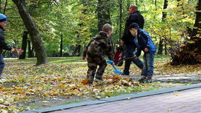 Children playing leaves autumn stock footage