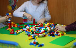 Children playing with lego. At kindergarten royalty free stock photo