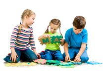 Children are playing letters Stock Images