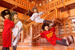 Children playing in a library Stock Photos