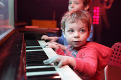 Children playing on light music piano. At playground royalty free stock images