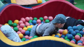 Children are playing with a lot of balls in pool stock footage