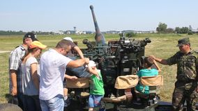 Children playing on a military cannon stock video footage