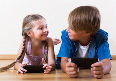 Children playing in mobile phones Stock Image
