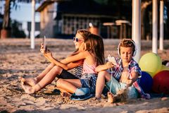 Children playing with mobile phones and tablet royalty free stock image