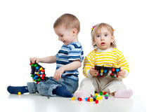Children playing with  mosaic toy Stock Images
