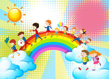 Children playing music in band over the rainbow Stock Image