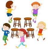 Children playing music chairs Stock Image