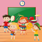 Children playing music in classroom Royalty Free Stock Photos