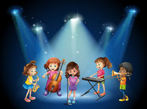 Children playing music in concert Royalty Free Stock Images