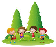 Children playing music and singing song Royalty Free Stock Images