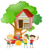 Children playing music under the tree Stock Photos
