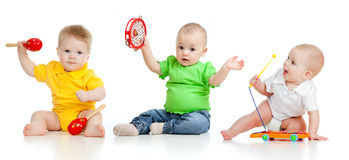 Children playing with musical toys. On white background Stock Image