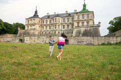 Children playing near the castle royalty free stock images