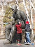 Children playing near the monument to Vasily Shukshin Stock Photos